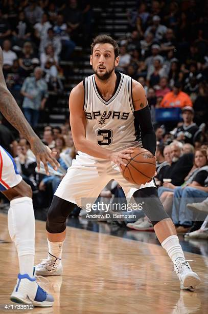 Marco Belinelli of the San Antonio Spurs looks to move the ball against the Los Angeles Clippers during Game Six of the Western Conference...