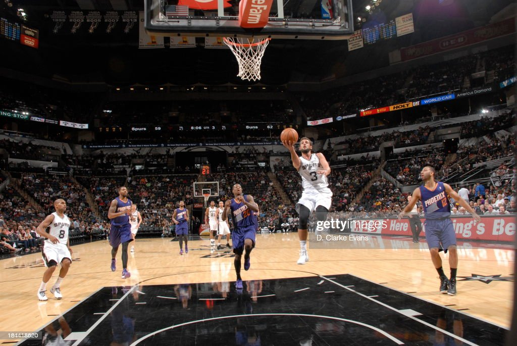 <a gi-track='captionPersonalityLinkClicked' href=/galleries/search?phrase=Marco+Belinelli&family=editorial&specificpeople=847592 ng-click='$event.stopPropagation()'>Marco Belinelli</a> #3 of the San Antonio Spurs puts up the finger roll against the Phoenix Suns during the preseason at the AT&T Center on October 13, 2013 in San Antonio, Texas.