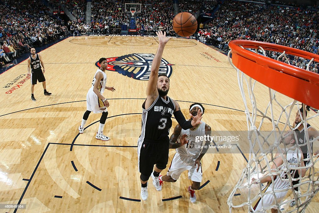 Marco Belinelli #3 of the San Antonio Spurs shoots against the New Orleans Pelicans on December 26, 2014 at Smoothie King Center in New Orleans, Louisiana.