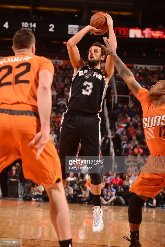 Marco Belinelli #3 of the San Antonio Spurs shoots against the Phoenix Suns on February 21, 2014 at U.S. Airways Center in Phoenix, Arizona.