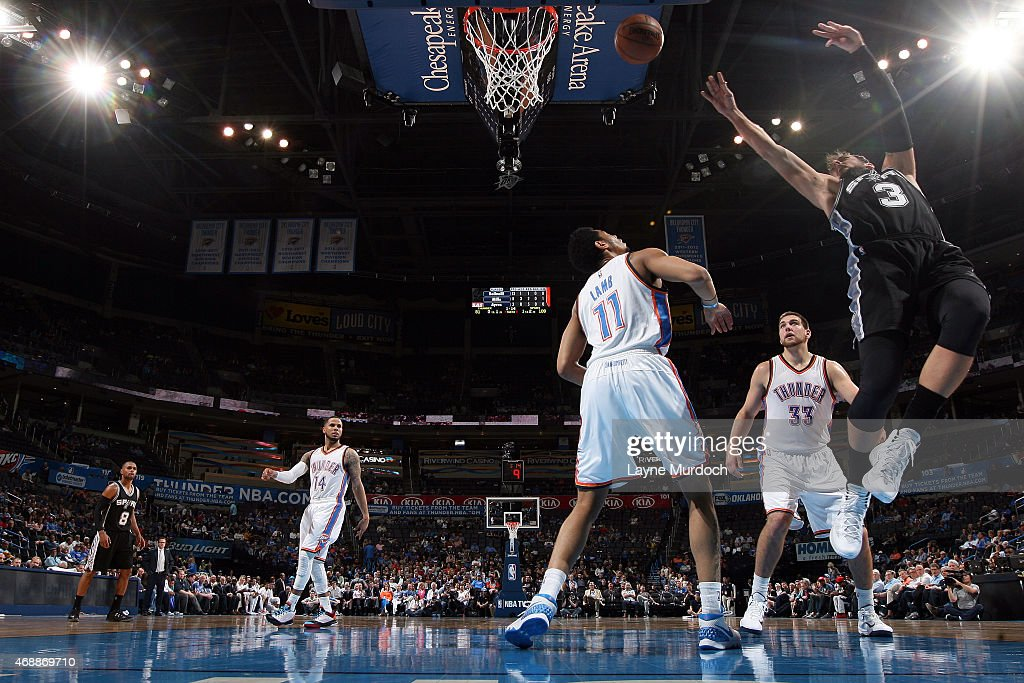 Marco Belinelli #3 of the San Antonio Spurs shoots the ball against the Oklahoma City Thunder on April 7, 2015 at Chesapeake Energy Arena in Oklahoma City, Oklahoma.