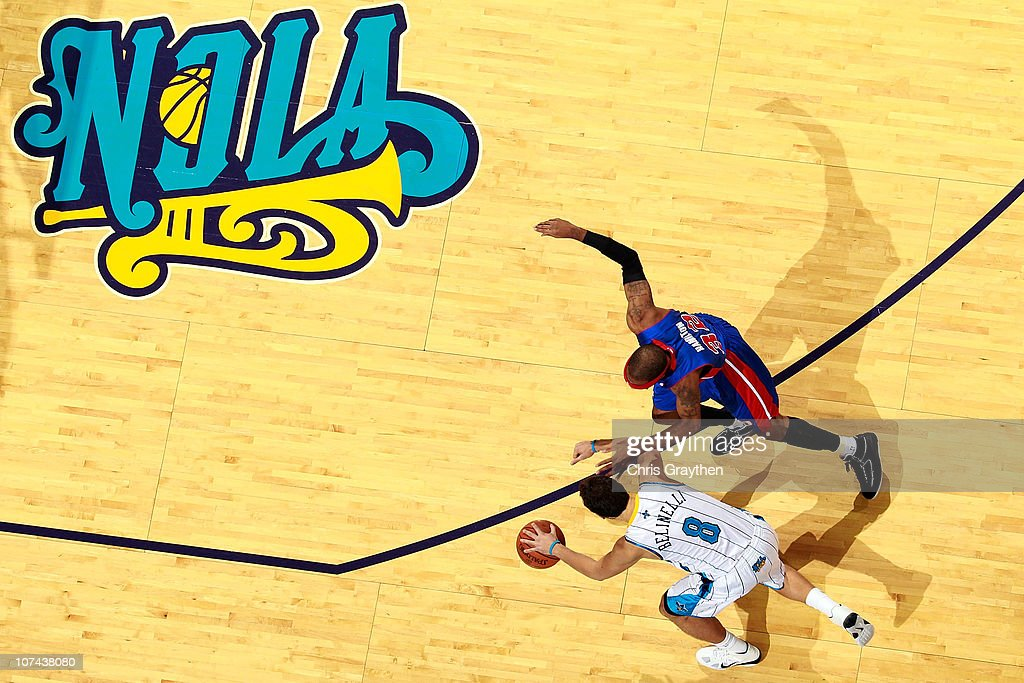 <a gi-track='captionPersonalityLinkClicked' href=/galleries/search?phrase=Marco+Belinelli&family=editorial&specificpeople=847592 ng-click='$event.stopPropagation()'>Marco Belinelli</a>l #8 of the New Orleans Hornets drives the ball around <a gi-track='captionPersonalityLinkClicked' href=/galleries/search?phrase=Richard+Hamilton&family=editorial&specificpeople=201498 ng-click='$event.stopPropagation()'>Richard Hamilton</a> #32 of the Detroit Pistons at the New Orleans Arena on December 8, 2010 in New Orleans, Louisiana. The Hornets defeated the Pistons 93-74.