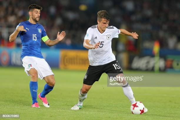 Marco Benassi MarcOliver Kempf during the UEFA U21 European Championship Group C football match Italy v Germany in Krakow Poland on June 24 2017