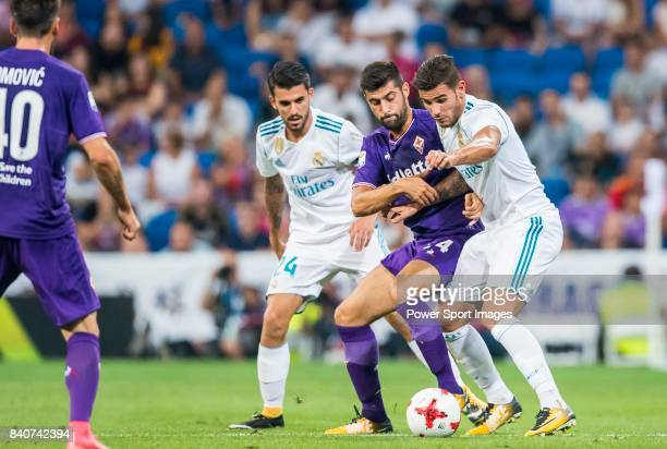 Marco Benassi of ACF Fiorentina fights for the ball with Theo Hernandez and Daniel Ceballos Fernandez Dani Ceballos of Real Madrid during the...