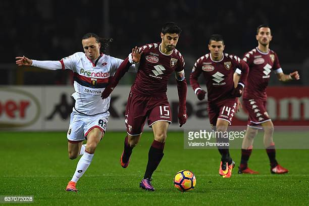 Marco Benassi of FC Torino competes with Diego Laxalt of Genoa CFC during the Serie A match between FC Torino and Genoa CFC at Stadio Olimpico di...