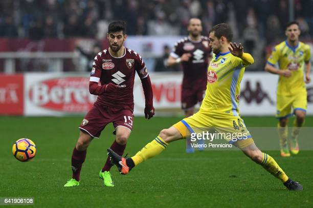 Marco Benassi of FC Torino in action against Michele Fornasier of Pescara Calcio during the Serie A match between FC Torino and Pescara Calcio at...