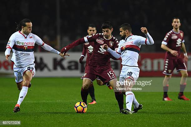 Marco Benassi of FC Torino is challenged by Tomas Rincon and Diego Laxalt of Genoa CFC during the Serie A match between FC Torino and Genoa CFC at...