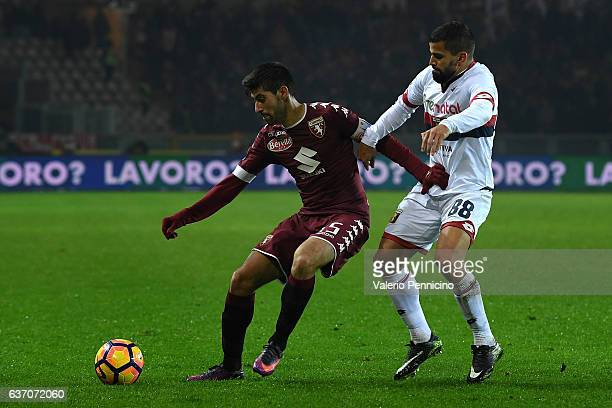 Marco Benassi of FC Torino is challenged by Tomas Rincon of Genoa CFC during the Serie A match between FC Torino and Genoa CFC at Stadio Olimpico di...