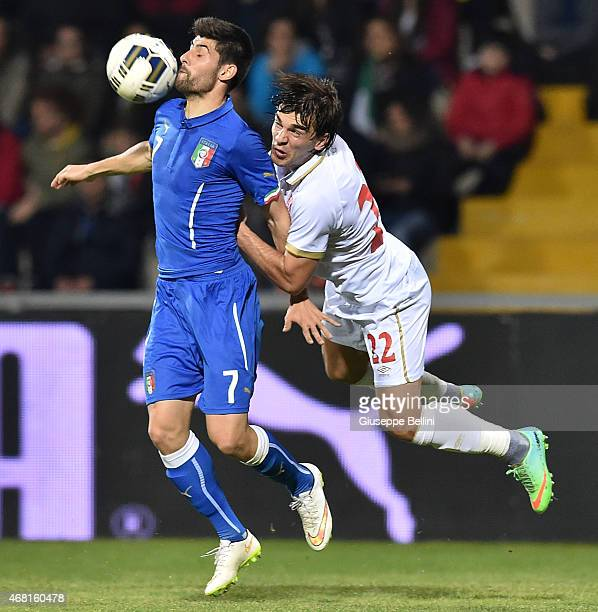 Marco Benassi of Italy and Filip Stojkovic of Serbia in action during the international friendly match between Italy U21 and Serbia U21 at Stadio...