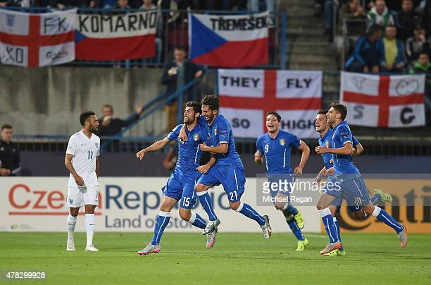 Marco Benassi of Italy celebrates with team mates after scoring to make it 20 as Nathan Redmond of England looks on during the UEFA Under21 European...