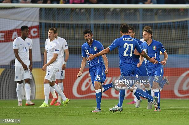 Marco Benassi of Italy celebrates with team mates after scoring to make it 20 during the UEFA Under21 European Championship match between England and...