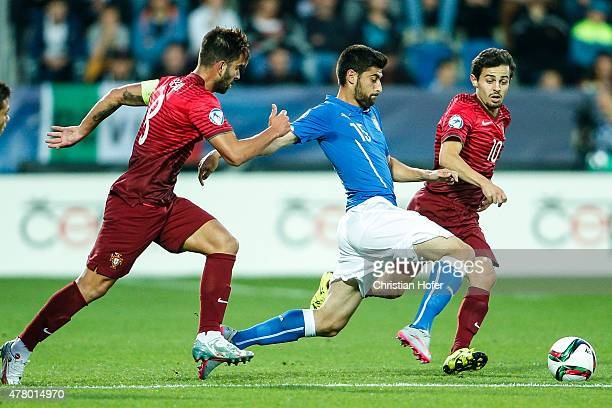 Marco Benassi of Italy competes for the ball with Sergio Oliveira and Bernardo Silva of Portugal during the UEFA Under21 European Championship 2015...