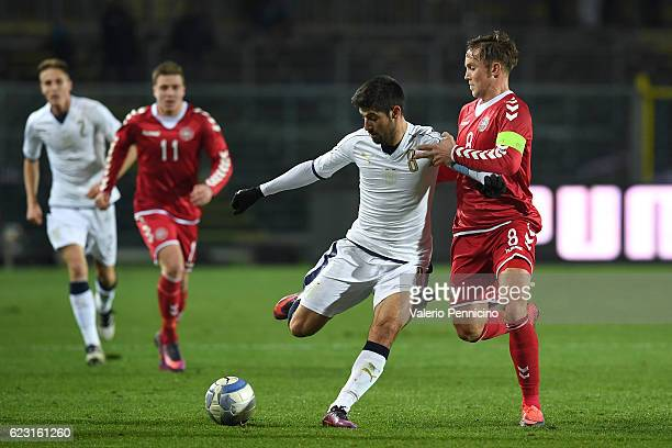 Marco Benassi of Italy is challenged by LasseVigen of Denmark during the International Friendly match between Italy U21 and Denmark U21 at Stadio...