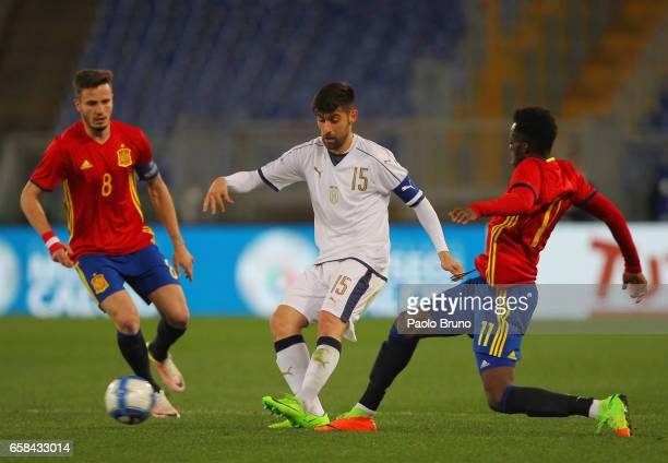Marco Benassi of Italy U21 competes for the ball with Spain U21 players during the international friendly match between Italy U21 and Spain U21 at...