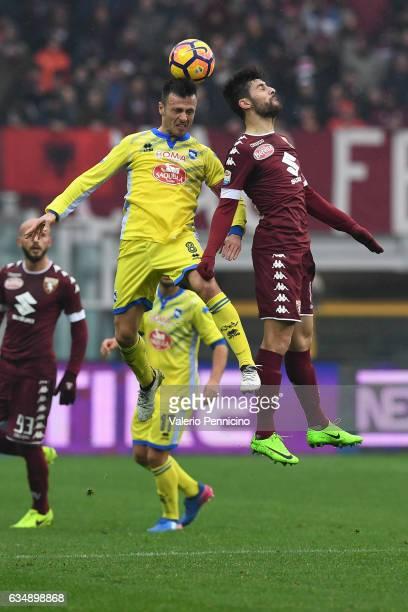 Marco Benassi R of FC Torino goes up with Ledian Memushaj of Pescara Calcio during the Serie A match between FC Torino and Pescara Calcio at Stadio...