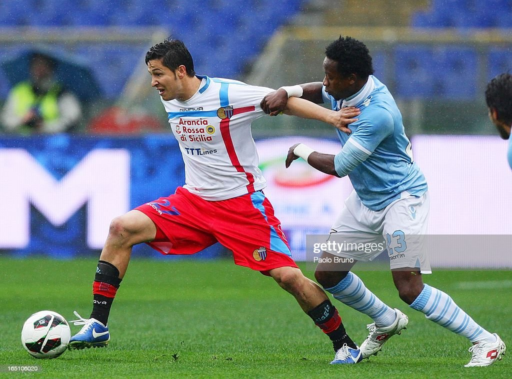 Marco Biagianti of Calcio Catania competes for the ball with Eddy Onazi (R) of S.S. Lazio during the Serie A match between S.S. Lazio and Calcio Catania at Stadio Olimpico on March 30, 2013 in Rome, Italy.