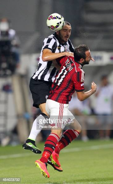 Marco Bonucci of FC Juventus competes for the ball with Giampaolo Pazzini of AC Milan during the TIM Preseason Tournament between US Sassuolo FC...