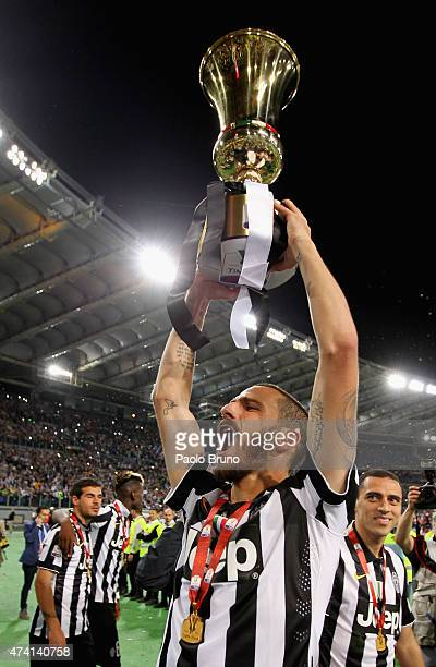 Marco Bonucci of Juventus FC celebrates with the trophy after winning the TIM Cup final match against SS Lazio at Olimpico Stadium on May 20 2015 in...