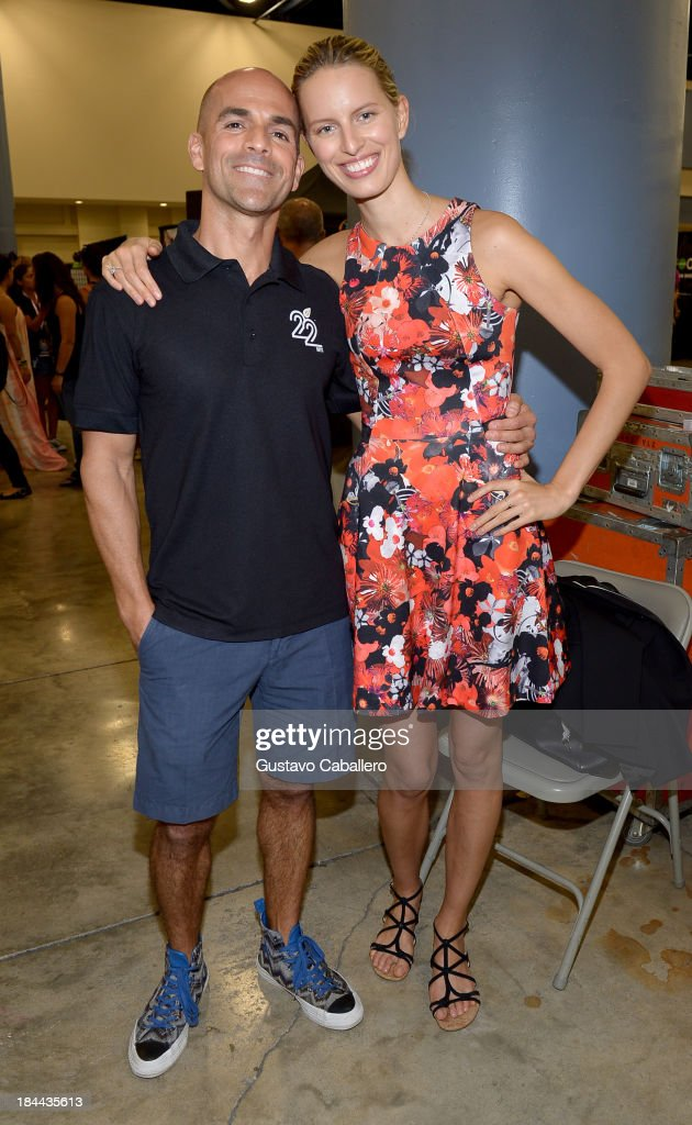 Marco Borges and <a gi-track='captionPersonalityLinkClicked' href=/galleries/search?phrase=Karolina+Kurkova&family=editorial&specificpeople=202513 ng-click='$event.stopPropagation()'>Karolina Kurkova</a> attends the Sweat USA America's All-Star Fitness Festival at the Miami Beach Convention Center on October 13, 2013 in Miami Beach, Florida.