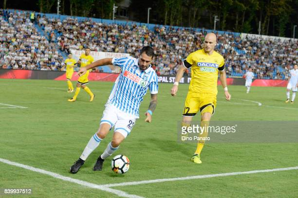 Marco Boriello of Spal competes with Bram Nuytinc of Udinese Calcio during the Serie A match between Spal and Udinese Calcio at Stadio Paolo Mazza on...