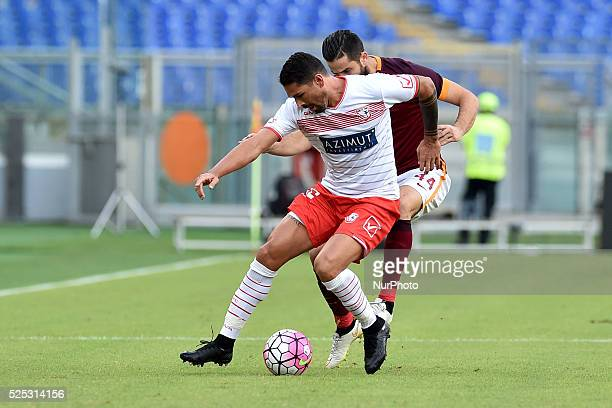 Marco Borriello is challenged by Kostantinos Manolas during the Italian Serie A match between AS Roma and FC Carpi at Stadio Olimpico in Rome on...