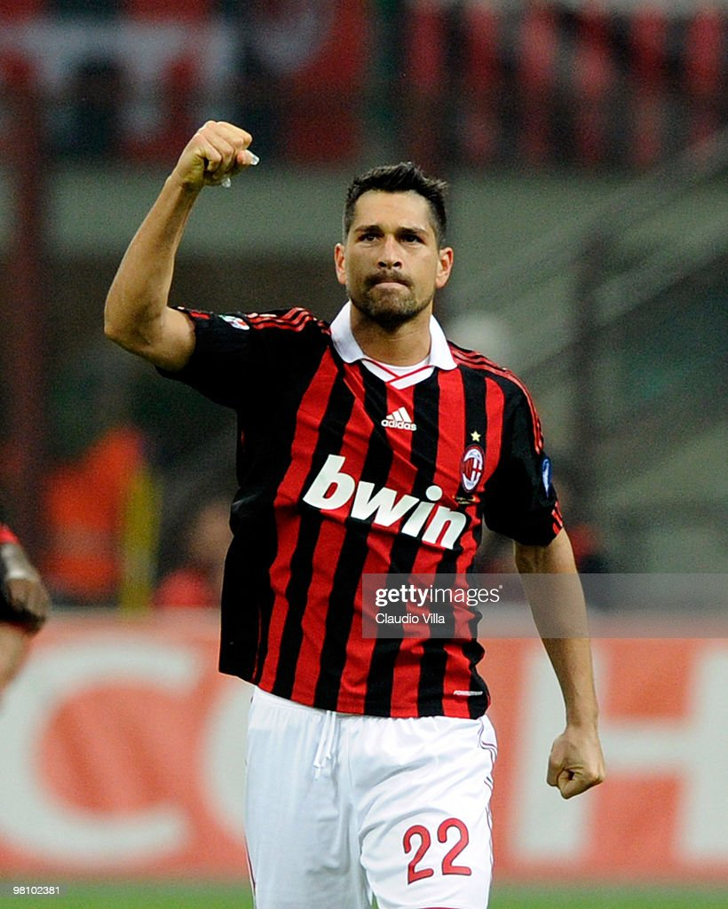 <a gi-track='captionPersonalityLinkClicked' href=/galleries/search?phrase=Marco+Borriello&family=editorial&specificpeople=709800 ng-click='$event.stopPropagation()'>Marco Borriello</a> of AC Milan celebrates after the first goal during the Serie A match between AC Milan and SS Lazio at Stadio Giuseppe Meazza on March 28, 2010 in Milan, Italy.