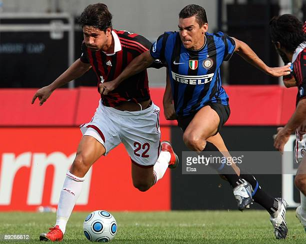 Marco Borriello of AC Milan tries to keep the ball from Lucio of Inter Milan on July 26 2009 during the World Football Challange at Gillette Stadium...