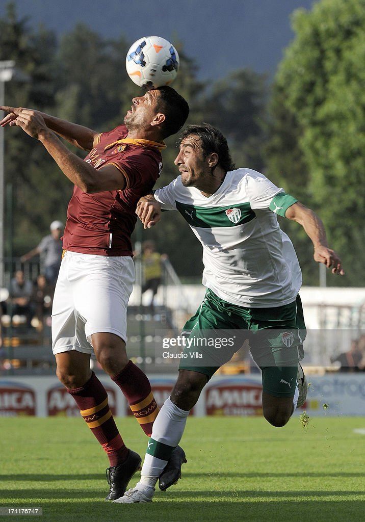 <a gi-track='captionPersonalityLinkClicked' href=/galleries/search?phrase=Marco+Borriello&family=editorial&specificpeople=709800 ng-click='$event.stopPropagation()'>Marco Borriello</a> of AS Roma and Ibrahim Ozturk of Bursaspor Kulubu (R) compete for the ball during the pre-season friendly match between AS Roma and Bursaspor Kulubu on July 21, 2013 in Bruneck, Italy.