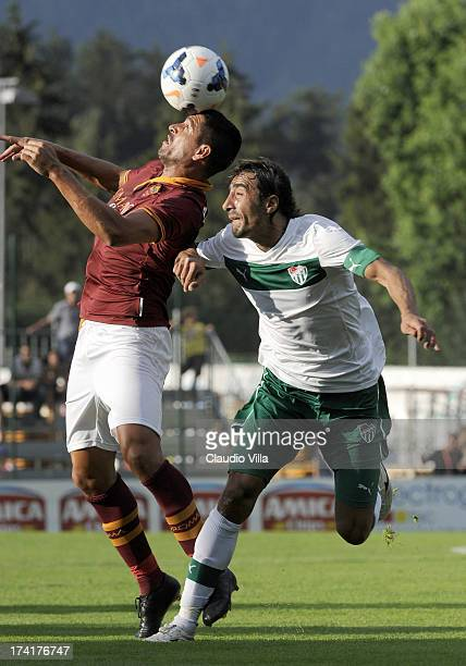 Marco Borriello of AS Roma and Ibrahim Ozturk of Bursaspor Kulubu compete for the ball during the preseason friendly match between AS Roma and...