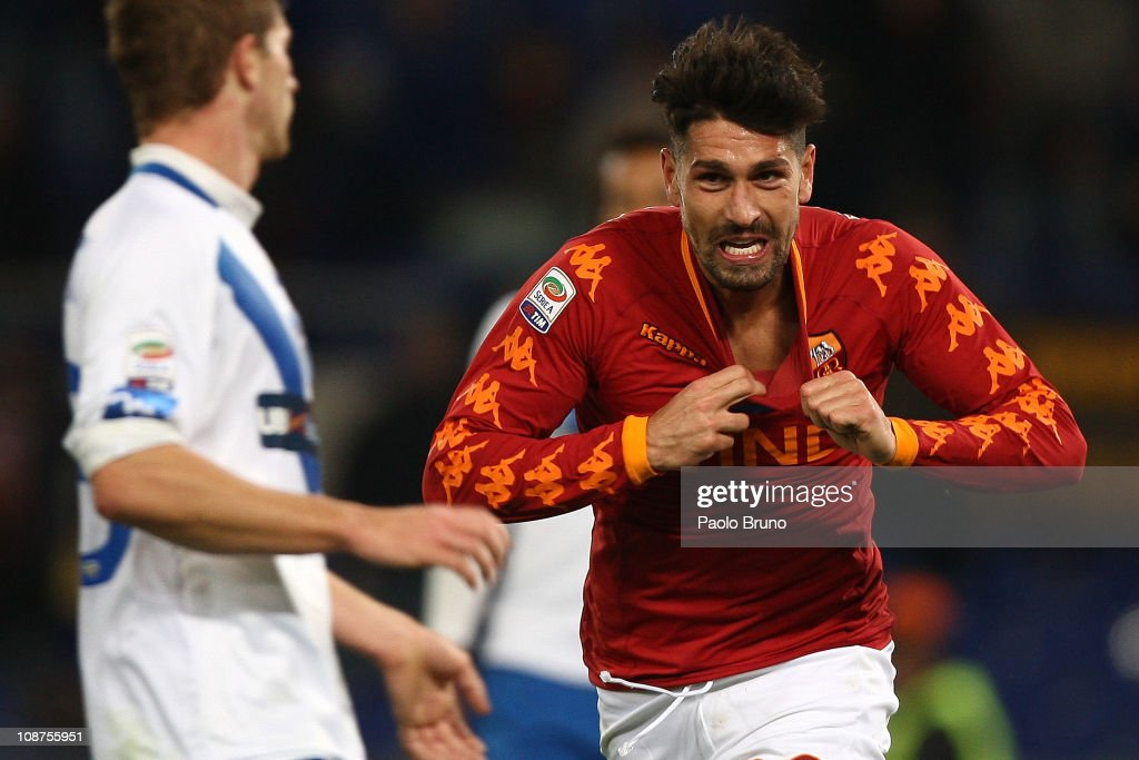 <a gi-track='captionPersonalityLinkClicked' href=/galleries/search?phrase=Marco+Borriello&family=editorial&specificpeople=709800 ng-click='$event.stopPropagation()'>Marco Borriello</a> of AS Roma celebrates after scoring the opening goal of the Serie A match between AS Roma and Brescia Calcio at Stadio Olimpico on February 2, 2011 in Rome, Italy.