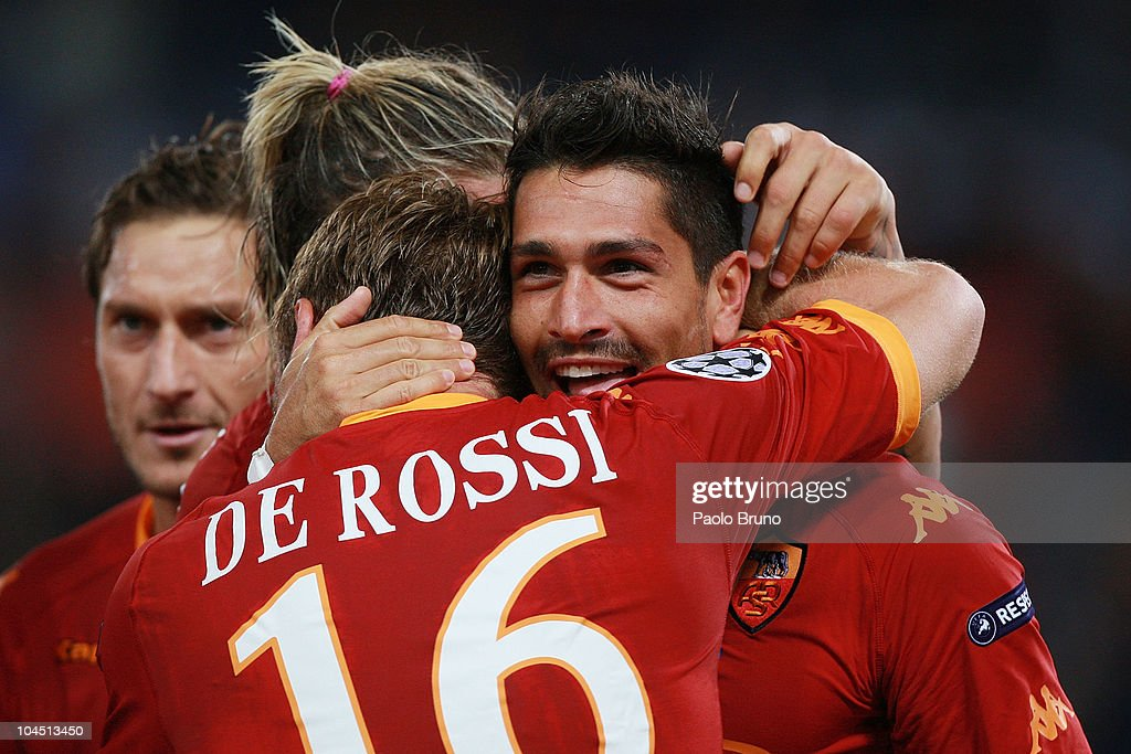 Marco Borriello (R) of AS Roma celebrates with Daniele De Rossi after scoring their team's 2-0 goal during the UEFA Champions League group E match between AS Roma and CFR Cluj at Stadio Olimpico on September 28, 2010 in Rome, Italy.
