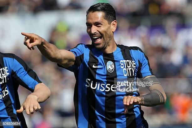 Marco Borriello of Atalanta BC celebrates after scoring the opening goal during the Serie A match between Atalanta BC and AC Chievo Verona at Stadio...