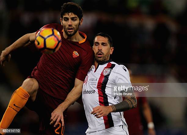 Marco Borriello of Cagliari Calcio competes for the ball with Federico Fazio of AS Roma during the Serie A match between AS Roma and Cagliari Calcio...