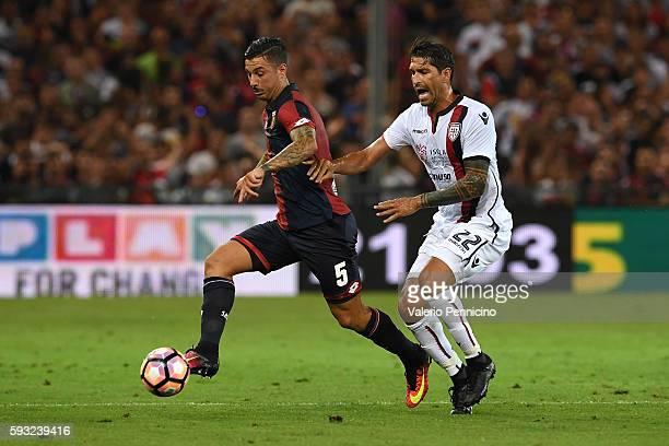 Marco Borriello of Cagliari Calcio competes with Armando Izzo of Genoa CFC during the Serie A match between Genoa CFC and Cagliari Calcio at Stadio...