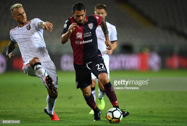 Marco Borriello of Cagliari Calcio in action against Aljaz Struna of US Citta di Palermo during the TIM Cup match between Cagliari Calcio and US...