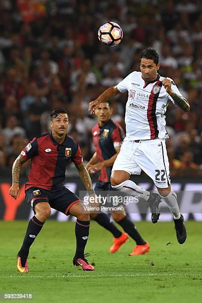 Marco Borriello of Cagliari Calcio in action against Armando Izzo of Genoa CFC during the Serie A match between Genoa CFC and Cagliari Calcio at...