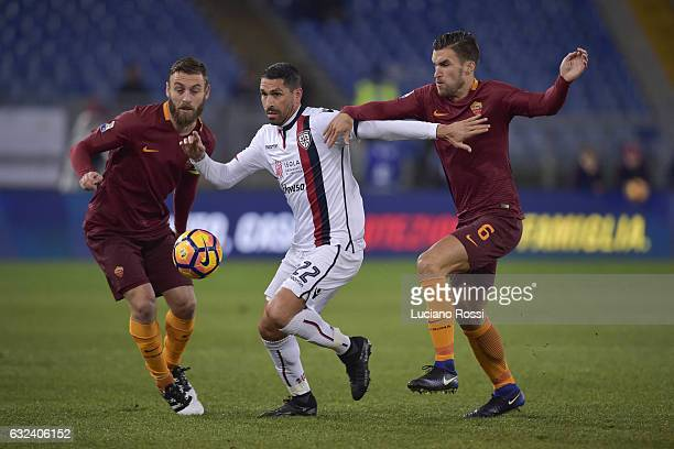 Marco Borriello of Cagliari Calcio is challenged by Daniele De Rossi and Kevn Strootman of AS Roma during the Serie A match between AS Roma and...
