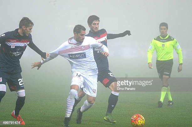 Marco Borriello of Carpi FC competes with Andrej Modic and Roberto Gagliardini of AC Vicenza during the TIM Cup match between Carpi FC and AC Vicenza...