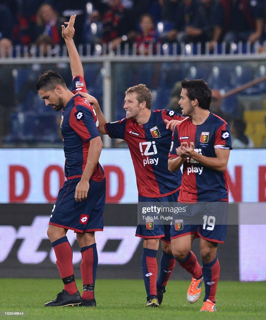 <a gi-track='captionPersonalityLinkClicked' href=/galleries/search?phrase=Marco+Borriello&family=editorial&specificpeople=709800 ng-click='$event.stopPropagation()'>Marco Borriello</a> (L) of Genoa celebrates with team-mates after scoring the equalizing goal during the Serie A match between Genoa CFC and US Citta di Palermo at Stadio Luigi Ferraris on October 6, 2012 in Genoa, Italy.