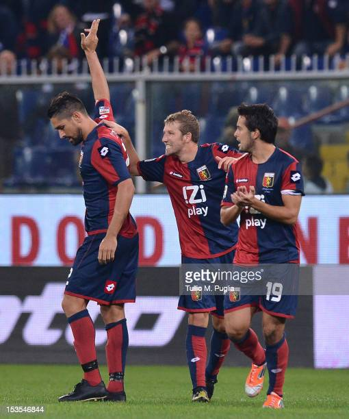 Marco Borriello of Genoa celebrates with teammates after scoring the equalizing goal during the Serie A match between Genoa CFC and US Citta di...