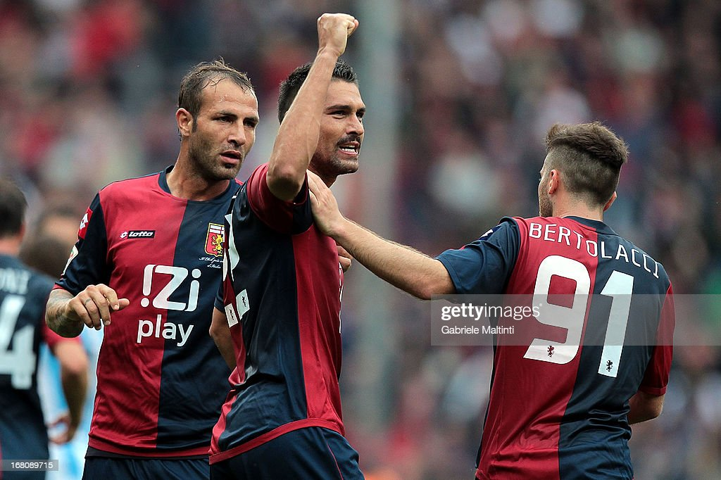 <a gi-track='captionPersonalityLinkClicked' href=/galleries/search?phrase=Marco+Borriello&family=editorial&specificpeople=709800 ng-click='$event.stopPropagation()'>Marco Borriello</a> (C) of Genoa CFC celebrates with team-mates after scoring a goal during the Serie A match between Genoa CFC and Pescara at Stadio Luigi Ferraris on May 5, 2013 in Genoa, Italy.