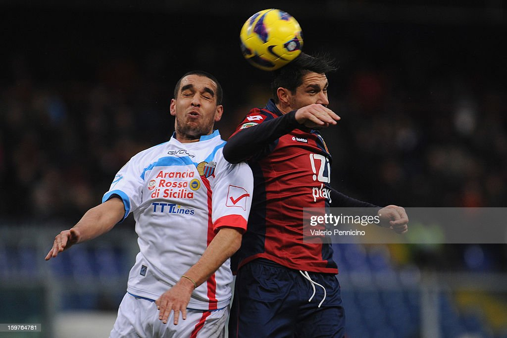 <a gi-track='captionPersonalityLinkClicked' href=/galleries/search?phrase=Marco+Borriello&family=editorial&specificpeople=709800 ng-click='$event.stopPropagation()'>Marco Borriello</a> (R) of Genoa CFC clashes with Giuseppe Bellusci of Calcio Catania during the Serie A match between Genoa CFC and Calcio Catania at Stadio Luigi Ferraris on January 20, 2013 in Genoa, Italy.