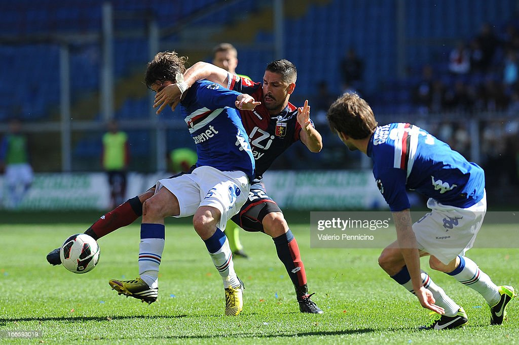 <a gi-track='captionPersonalityLinkClicked' href=/galleries/search?phrase=Marco+Borriello&family=editorial&specificpeople=709800 ng-click='$event.stopPropagation()'>Marco Borriello</a> (R) of Genoa CFC competes with <a gi-track='captionPersonalityLinkClicked' href=/galleries/search?phrase=Andrea+Poli&family=editorial&specificpeople=4520865 ng-click='$event.stopPropagation()'>Andrea Poli</a> of UC Sampdoria during the Serie A match between Genoa CFC and UC Sampdoria at Stadio Luigi Ferraris on April 14, 2013 in Genova, Italy.