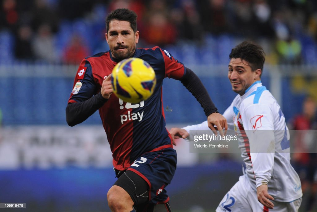 <a gi-track='captionPersonalityLinkClicked' href=/galleries/search?phrase=Marco+Borriello&family=editorial&specificpeople=709800 ng-click='$event.stopPropagation()'>Marco Borriello</a> (L) of Genoa CFC in action during the Serie A match between Genoa CFC and Calcio Catania at Stadio Luigi Ferraris on January 20, 2013 in Genoa, Italy.