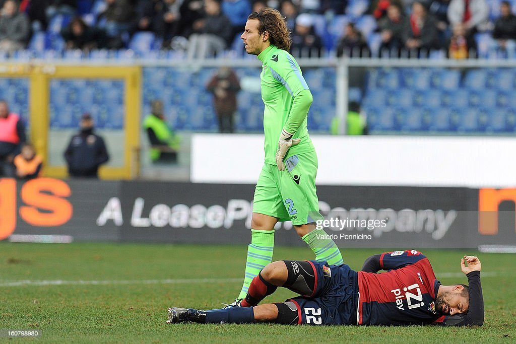 Marco Borriello (R) of Genoa CFC lies injured during the Serie A match between Genoa CFC and SS Lazio at Stadio Luigi Ferraris on February 3, 2013 in Genoa, Italy.