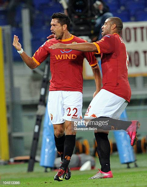 Marco Borriello of Roma celebrates his 20 goal with teammate Adriano during the UEFA Champions League group E match between AS Roma and CFR Cluj at...