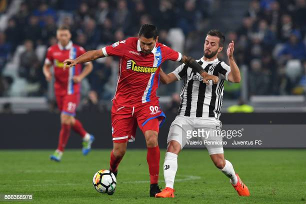 Marco Borriello of Spal and Miralem Pjanic of Juventus compete for the ball during the Serie A match between Juventus and Spal on October 25 2017 in...