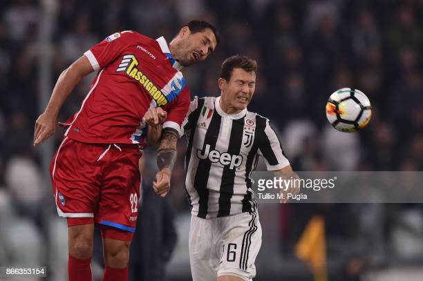 Marco Borriello of Spal and Stephan Lichtsteiner of Juventus compete for tyhe ball during the Serie A match between Juventus and Spal on October 25...