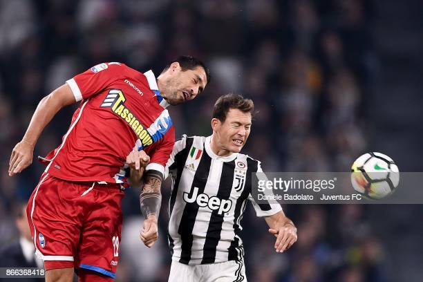 Marco Borriello of Spal and Stephan Lichtsteiner of Juventus compete for the ball during the Serie A match between Juventus and Spal on October 25...