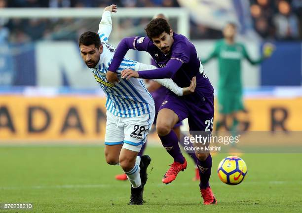Marco Borriello of Spal battles for the ball with Gil Dias of ACF Fiorentina during the Serie A match between Spal and ACF Fiorentina at Stadio Paolo...